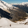 Descending snow slopes below Desperation Pass, Destiny Ridge dominating the image.