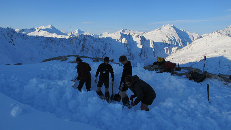 Digging out a trench for our tents, Edward, Aspiring, Avalanche and Tyndall behind.