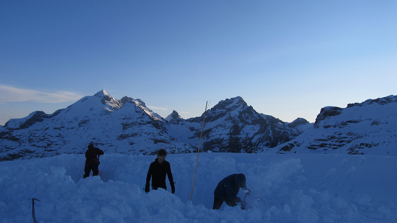 Digging out a trench for our tents, Earnslaw, Pluto and Sir William behind.