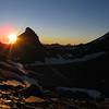 Sun setting behind Pluto Peak.