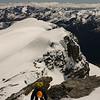 Downclimbing below the summit.