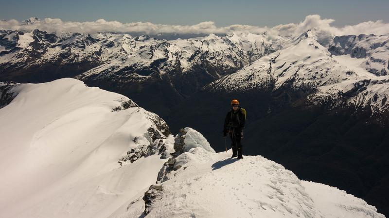 James on the West Ridge of Mt Head, Tutoko on the left in the distance, Albert Peak on the right.