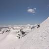 Climbing up an iced up summit pyramid.