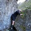 James tackling a boulder problem in Newland Stream.