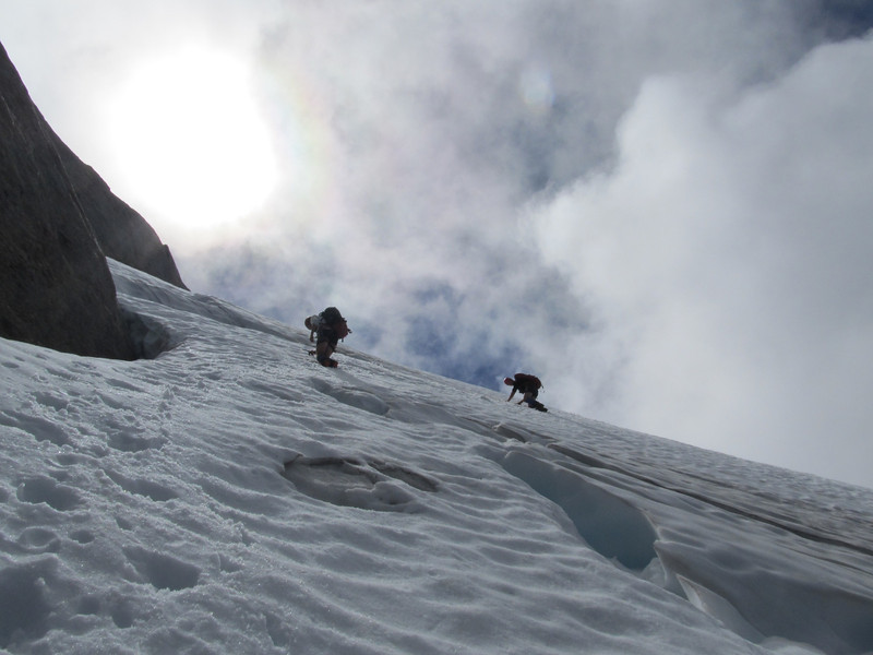 Downclimbing the rather bare glacier.