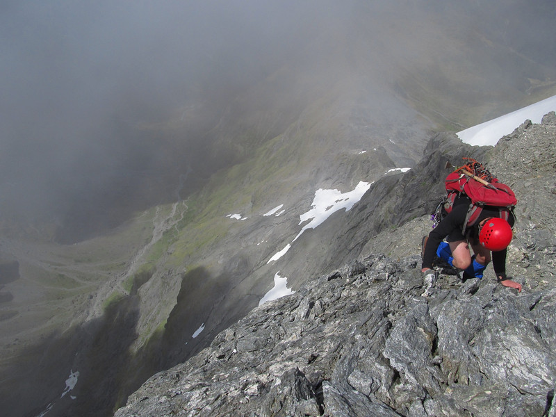 Downclimbing the summit ridge, the Young Basin below.