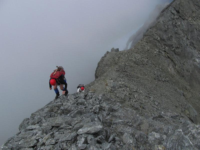 On the exposed summit ridge.