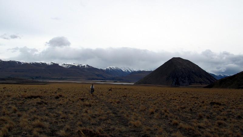 James biking to Double Hut, Lake Heron behind.