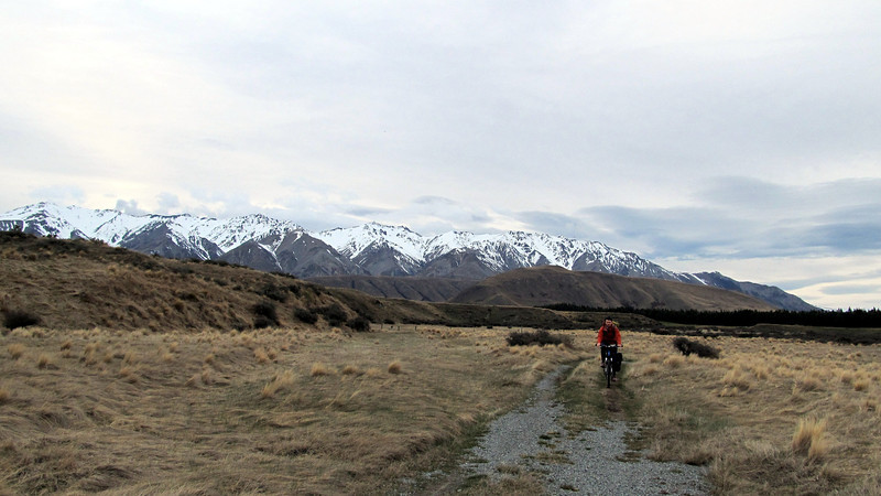James biking to Double Hut, Taylor Range behind.