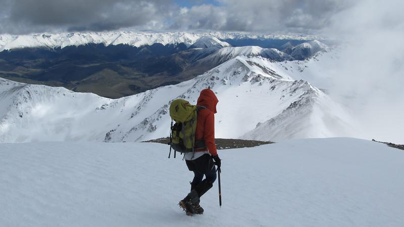 James descending off Mt Torlesse looking towards Junction Peak.