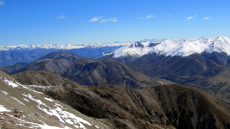 View from Pt 1741m. Note the glider in the centre image, Mt Cook in the far distance above the right wing and the Arrowsmiths further right.