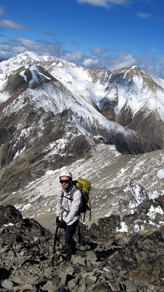 James climbing up to Pt. 1741m. The ridge we traversed is in the distance, with Mt Torlesse furthest right and Red Peak on the left.