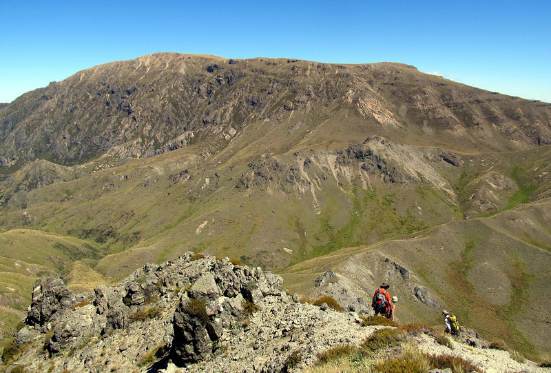Descent into Boyers Stream and Mt Somers above.