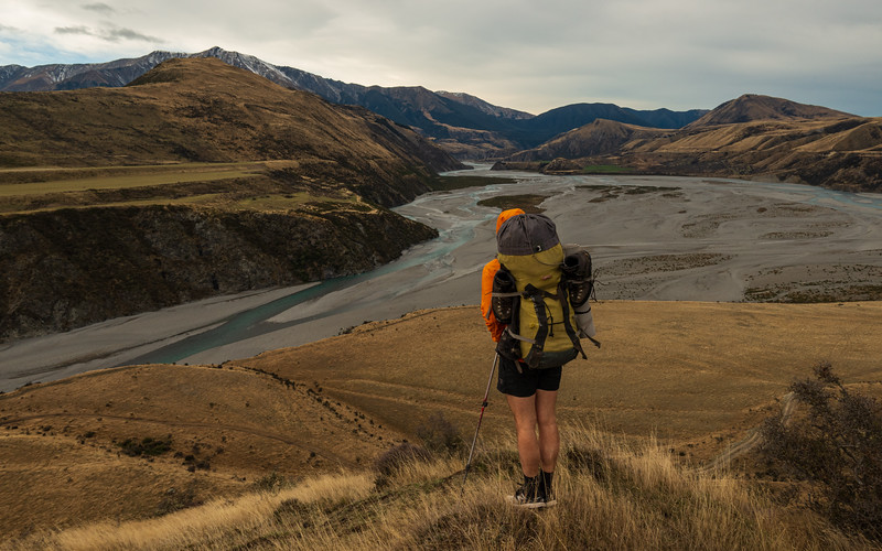 Dropping down to the Waimak riverbed at confluence with the Poulter, Chest Peak in the distance.