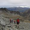 Descending the scree slope below Cecil Peak.