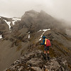 On the SE ridge of Eyre Peak, which is in the mist above.