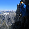 Danilo belaying on the south face of Terror Peak. Lady of the Snows on the distance.
