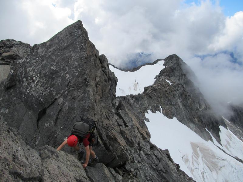 Jaz downclimbing the ridge on Talbot.
