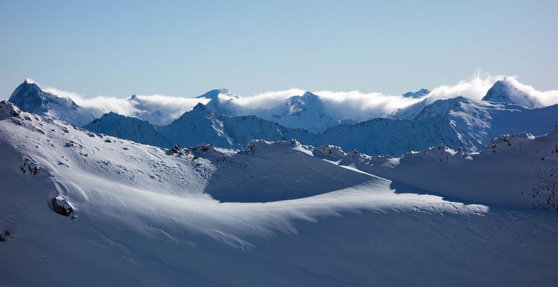 Cloud spilling over the divide: Mt Ward far left, Mt Dechen centre, Mt McKerrow far right.