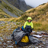 Staying warm at morning tea in the valley between Abseil and College Peaks (photo - James Thornton).