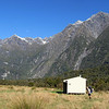 Reaching Cassel Flat Hut, Karangarua. McGloin Peak and the Bare Rocky Range above.