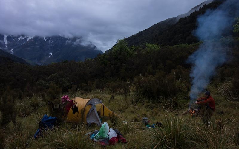 Camp near Uaroa Creek, Mt Hawkins in the cloud down valley.