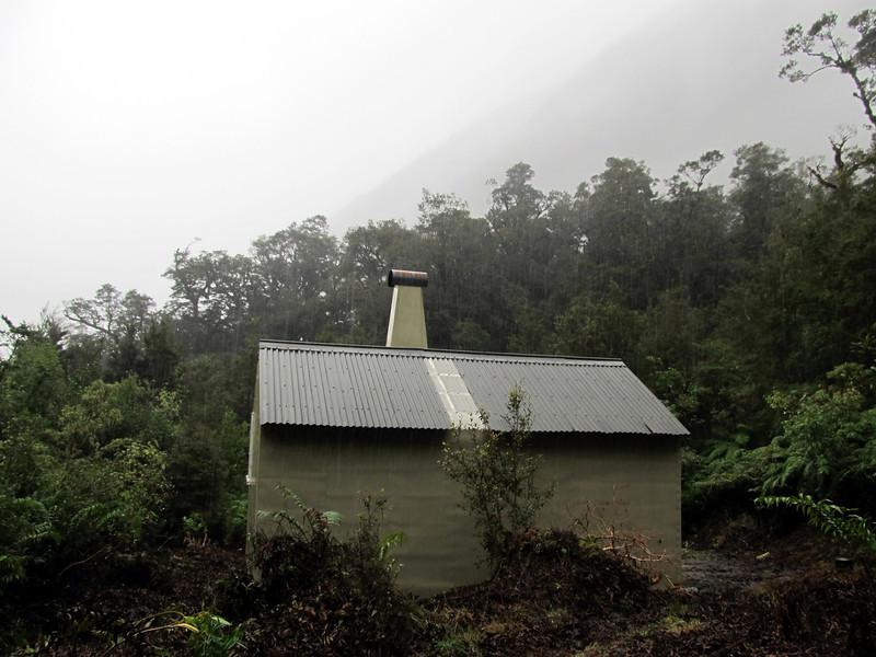 Middle Head Hut in the rain.