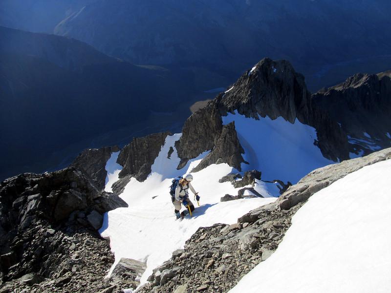 Marta climbing steep snow on the East Ridge.