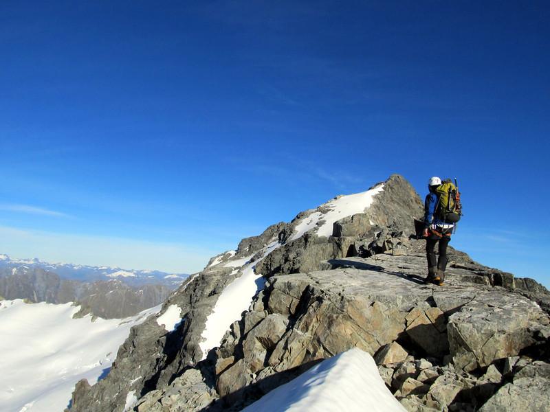 Level section on the East ridge. False summit behind.