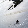 Abseiling a schrund on the South Face using a snow bollard (Photo - James Thornton).