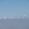 Rob Roy, Mt Avalanche and Mt Aspiring poking out of the cloud.