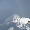 Jaz belaying Jono to the summit.