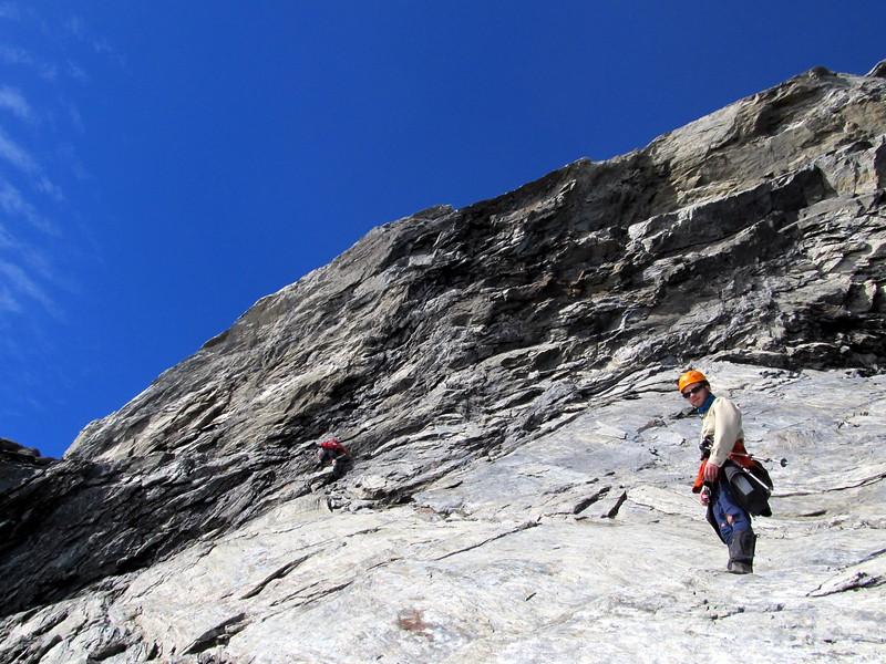 Neil downclimbing the last little steep bit.