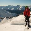 Allan near the summit of Glenisla, the Dobson valley and Ben Ohau Range behind him.