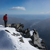 James on the summit of Hawkins looking toward the Mahitahi river mouth.