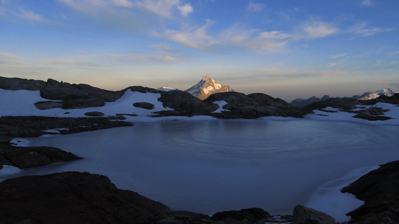 Frozen tarn below Mt Hickson with Mt Hooker.