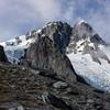 James dwarfed by the Hooker Glacier and Mt Hooker.