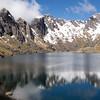 Lake Roto Te Koeti. Our route back into the Karangarua crossed the saddle in the centre image.