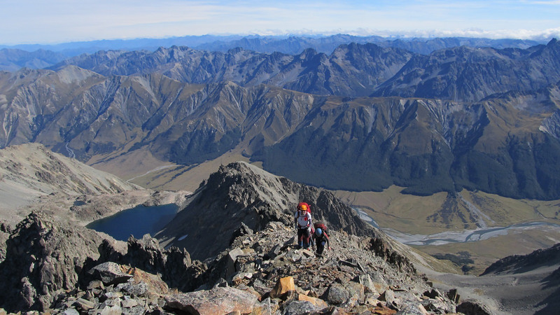 Along the summit ridge.