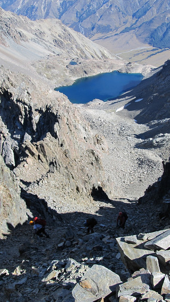 Scrambling up a chossy gully to reach the summit ridge of Saint Mary.