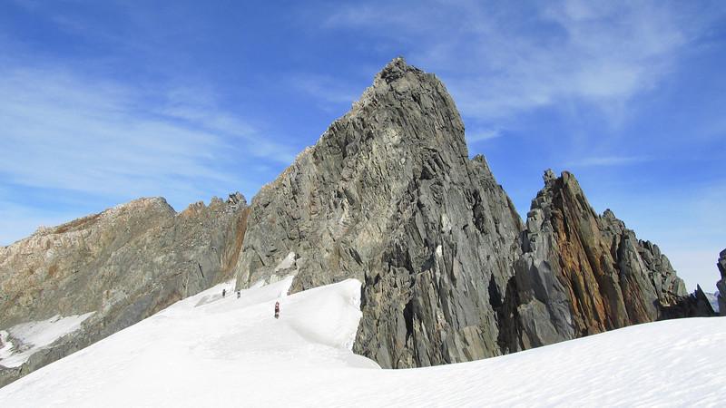Traversing the permanent snowfield below Rabbiters Peak.