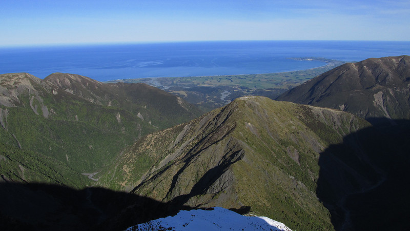 Looking down Surveyor Spur towards Stace Saddle. Hapuku on the left, Stace Creek on the right, Kaikoura peninsula behind.
