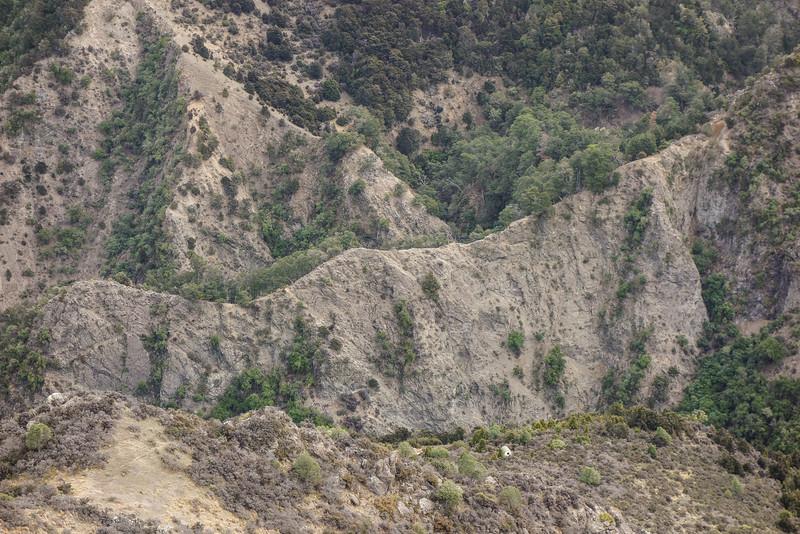 Kahutara Biv above the crazy topography of Kahutara Stream.