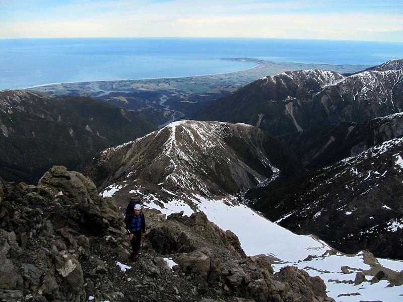 On rotten rock high on Surveyor Spur, Kaikoura Peninsula in the distance.