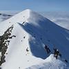 On the ridge between the subsidary peak of Snowflake and Snowflake looking back towards the subsidary peak.
