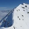 On the ridge between the subsidary peak of Snowflake and Snowflake looking back towards Snowflake.
