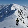 On the ridge between the subsidary peak of Snowflake and Snowflake.