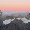 Cloud spilling over the Main Divide at sunrise.