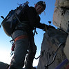 Me climbing the summit rocks (Thanks to Jaz for the photo).