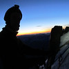 Jaz high on the summit rocks at sunrise.